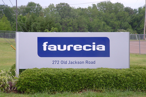 Faurecia - lighted cabinet, aluminum face with pushed-through acrylic copy